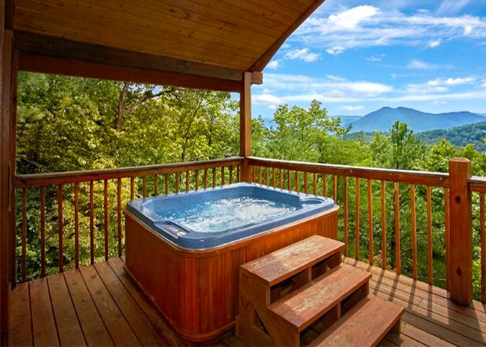Cabin's Deck with a Hot Tub and Mountain View